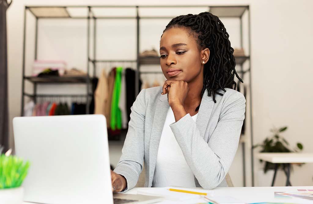 female IT specialist focused working on laptop