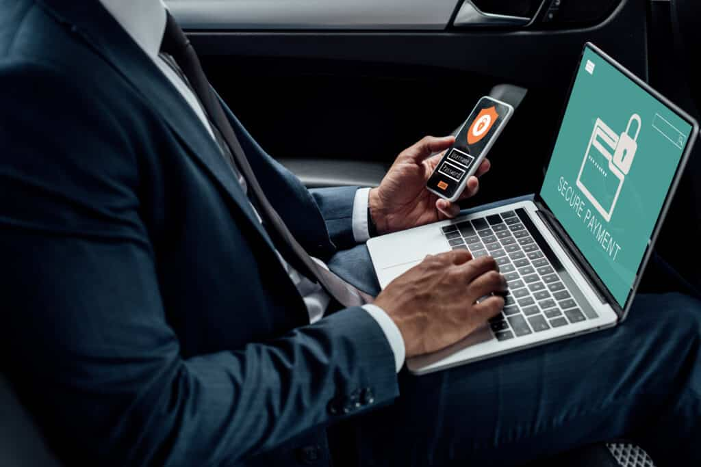 IT specialist holding a phone making a website secure for payment