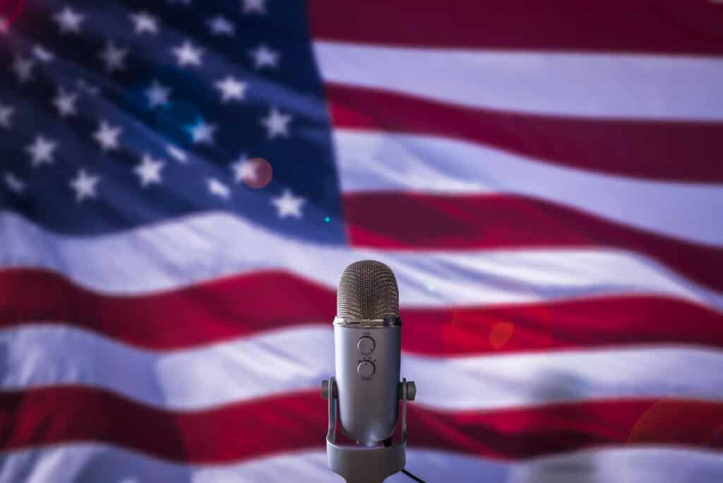 Microphone with American flag behind it